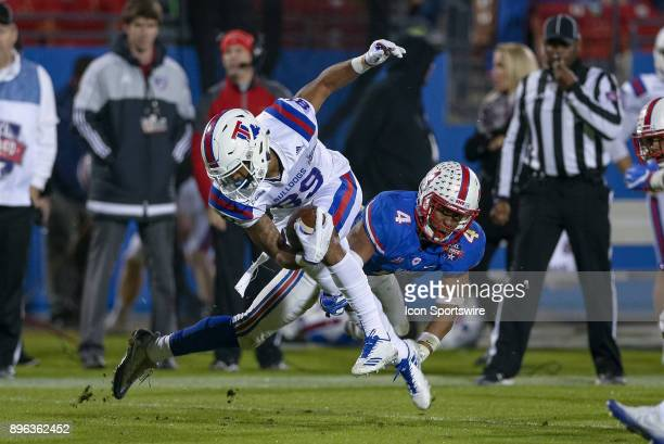 Louisiana Tech Bulldogs wide receiver Adrian Hardy is tripped up by Southern Methodist Mustangs safety Mikial Onu during the DXL Frisco Bowl game...