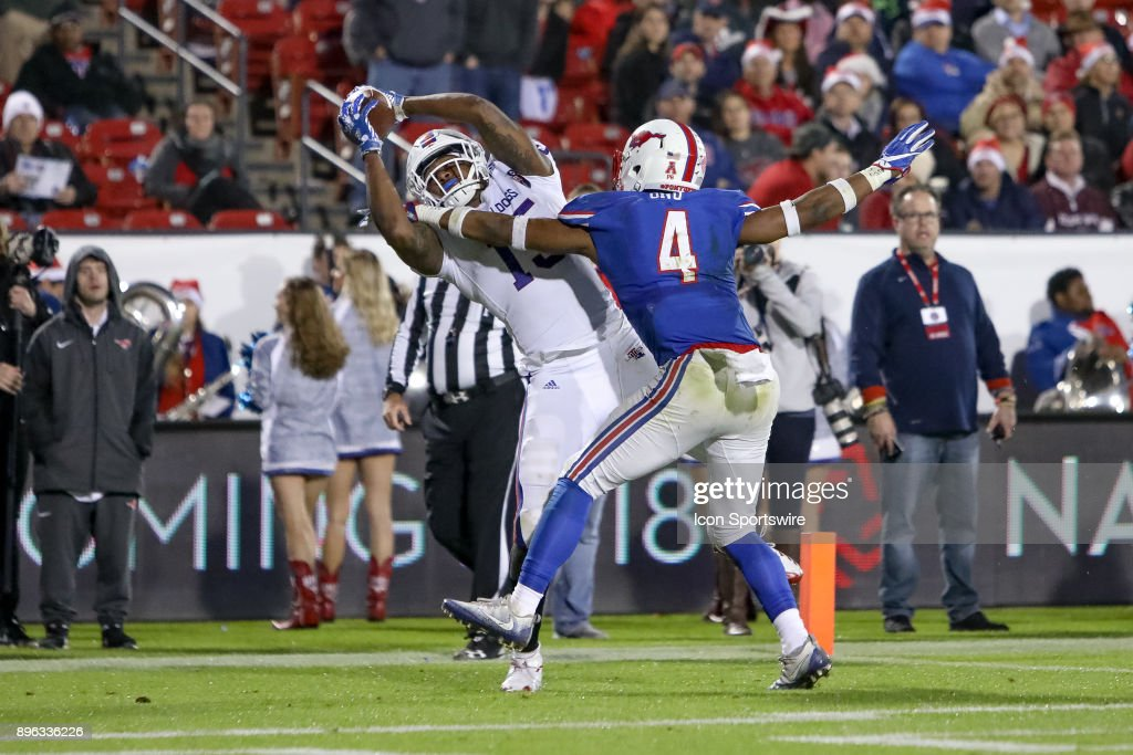 Louisiana Tech Bulldogs wide receiver Kam McKnight (15) makes a touchdown reception over Southern Methodist Mustangs safety Mikial Onu (4) during the DXL Frisco Bowl game between the Louisiana Tech Bulldogs and SMU Mustangs on December 20, 2017 at Toyota Stadium in Frisco, TX.