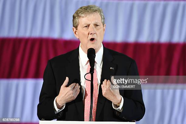 Louisiana Treasurer and Republican Senate candidate John Kennedy speaks at a 'getoutthevote' rally with US Presidentelect Donald Trump on December 9...