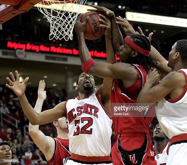 Louisiana-Lafayette's Tiras Wade pulls down a rebound against NC State's Jordan Collins and Levi Watkins during the Wolfpack's 78-72 win Wednesday,...