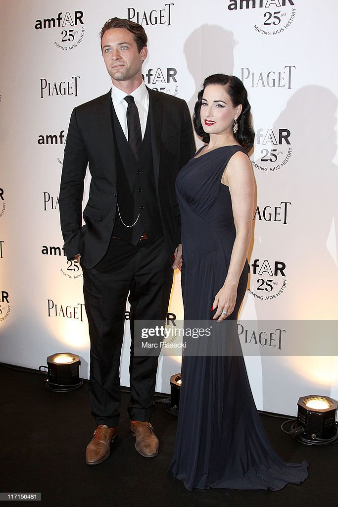 Louis-Marie de Castelbajac and Dita von Teese attend the amfAR Inspiration Gala photocall at Pavillon Gabriel on June 23, 2011 in Paris, France.