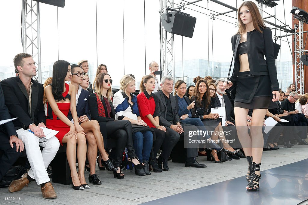 Louis-Marie de Castelbajac, Xing Tong Yaho, Guest, Sara Forestier, Melanie Thierry, Melanie Bernier, CEO Dior Sidney Toledano and his daughter Julia Toledano attend Maxime Simoens show as part of the Paris Fashion Week Womenswear Spring/Summer 2014, held at Orangerie du parc Andre Citroen on September 29, 2013 in Paris, France.