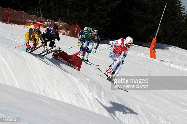 LouisPierre Helie of Canada Jouni Pellinen of Finland Andreas Schauer of Germany and Sylvain Miaillier of France compete during the men's FIS...