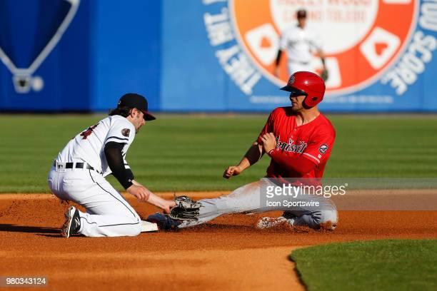 Louisville Bats shortstop Nick Senzel slides safely into second base while Toledo Mud Hens shortstop Pete Kozma puts the tag on him during a regular...