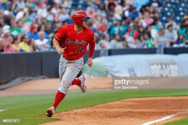 Louisville Bats third baseman Nick Senzel looks for the ball as he rounds third base during a regular season game between the Louisville Bats and the...