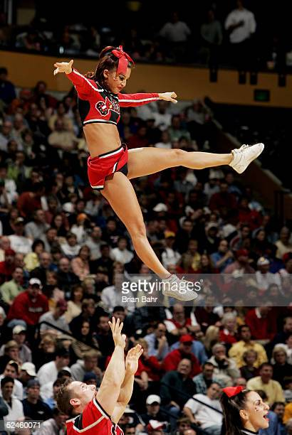 Louisville Cardinals' cheerleader is tossed into the air during a stoppage in play against the Georgia Tech Yellow Jackets in the second round of the...