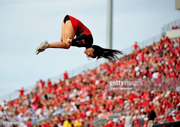 Louisville Cardinals cheerleader performs during a game against the North Carolina Tar Heels at Papa John's Cardinal Stadium on September 15, 2012 in...