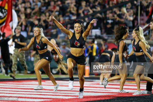 Louisville Cardinals cheerleaders celebrate a Louisville touchdown during the first quarter of the college football game between the Notre Dame...