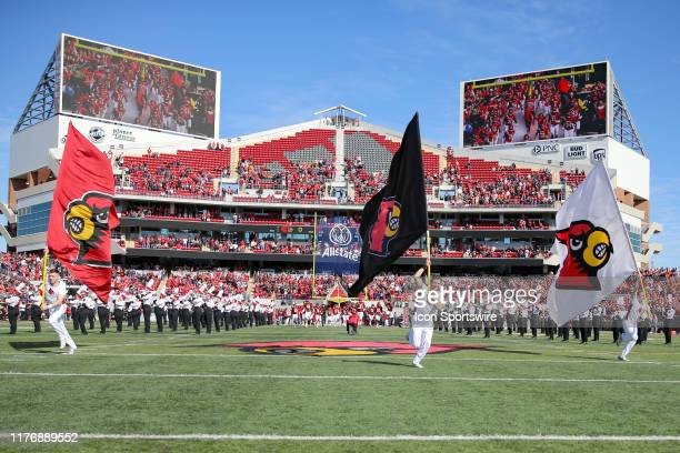 Louisville Cardinals cheerleaders lead the Cardinals on to the field prior to the college football game between the Clemson Tigers and Louisville...