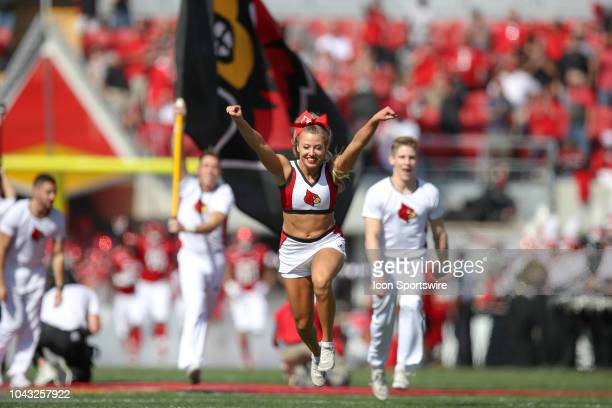 Louisville Cardinals cheerleaders lead the Cardinals onto the field prior to the college football game between the Florida State Seminoles and...