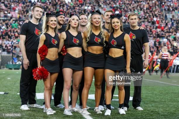 Louisville Cardinals cheerleaders on the field priorto the college football game between the Notre Dame Fighting Irish and Louisville Cardinals on...