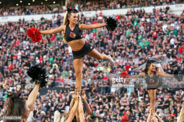 Louisville Cardinals cheerleaders perform on the field prior to the college football game between the Notre Dame Fighting Irish and Louisville...