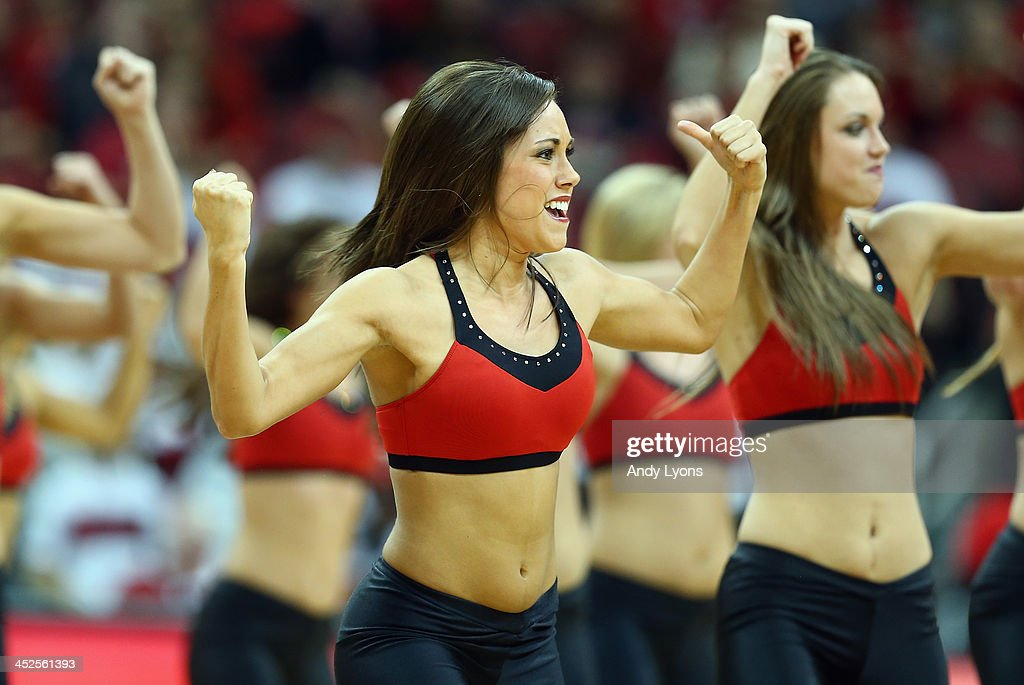Louisville Cardinals dance team members perform during the game against the Southern Mississippi Golden Eagles at KFC YUM! Center on November 29, 2013 in Louisville, Kentucky.