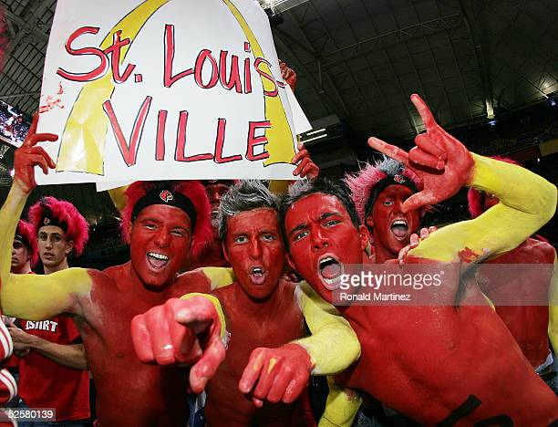 Louisville Cardinals fans Tony Kamer Stephen Candido and Michael Sticklen cheer their team on against the Illinois Fighting Illini before the start...