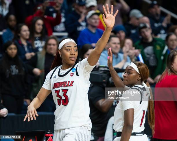 Louisville Cardinals Forward Bionca Dunham waves to fans after the game between the Connecticut Huskies and the Louisville Cardinals on March 31 at...