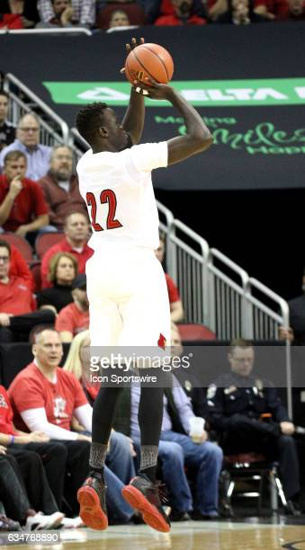 Louisville Cardinals forward Deng Adel shoots a 3 point shot in the first half during a men's college basketball game between the Miami Gators and...