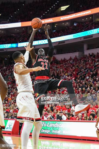 Louisville Cardinals forward Deng Adel with the off balanced jump shot during the men's college basketball game between the Louisville Cardinals and...