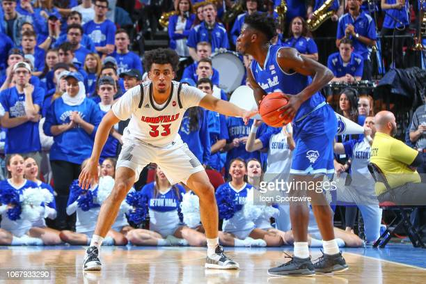 Louisville Cardinals forward Jordan Nwora defends Seton Hall Pirates guard Myles Cale during the first half of the College Basketball game between...