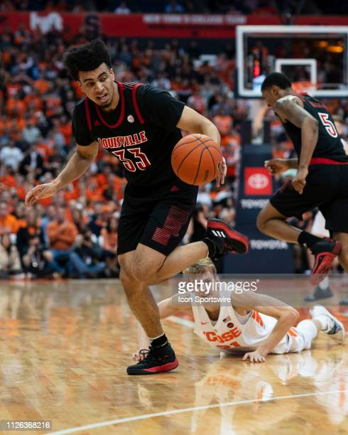 Louisville Cardinals Forward Jordan Nwora grabs a loose ball during the first half of the game between the Louisville Cardinals and the Syracuse...