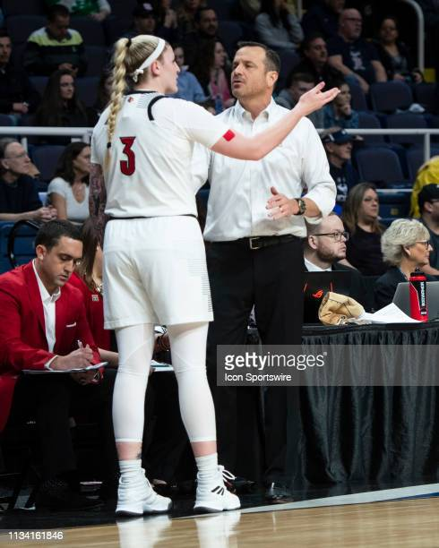 Louisville Cardinals Forward Kylee Shook speaks with Louisville Cardinals Head Coach Jeff Walz during the first half of the game between the...