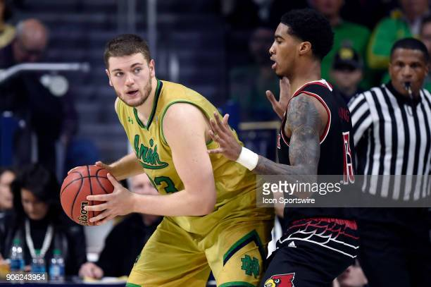 Louisville Cardinals forward Ray Spalding battles with Notre Dame Fighting Irish forward Martinas Geben during the college basketball game between...