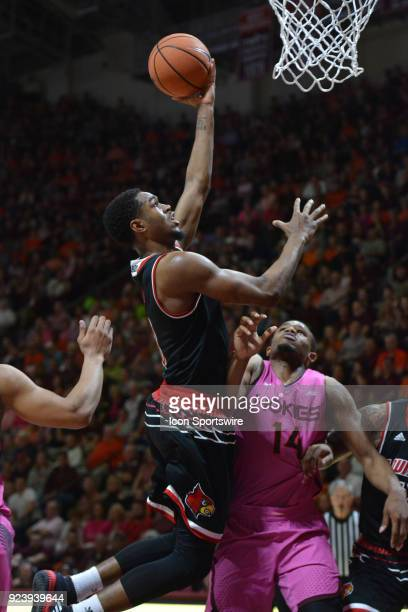 Louisville Cardinals forward Ray Spalding lays it in over Virginia Tech Hokies forward PJ Horne during a college basketball game on February 24 at...