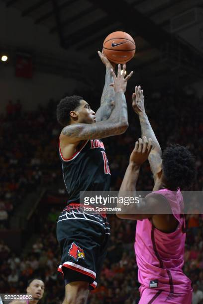 Louisville Cardinals forward Ray Spalding shoots over Virginia Tech Hokies guard Ahmed Hill during a college basketball game on February 24 at...