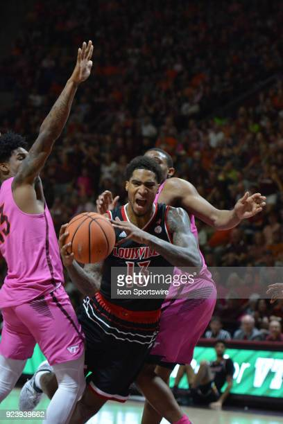 Louisville Cardinals forward Ray Spalding split two Virginia Tech Hokies defenders during a college basketball game on February 24 at Cassell...