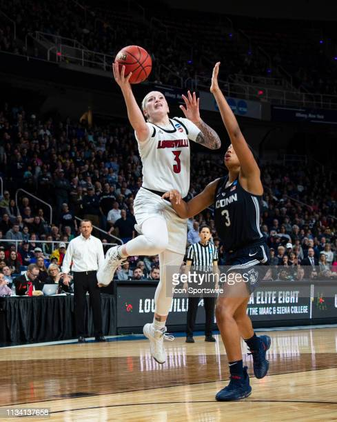 Louisville Cardinals Forward Sam Fuehring shoots a layup with Connecticut Huskies Guard / Forward Megan Walker defending during the second half of...