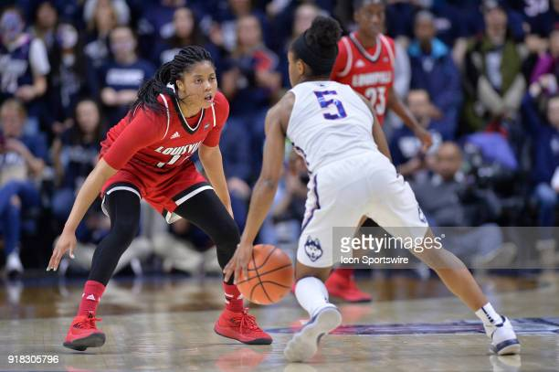 Louisville Cardinals Guard Arica Carter defends UConn Huskies Guard Crystal Dangerfield during the game as the UConn Huskies host the Louisville...
