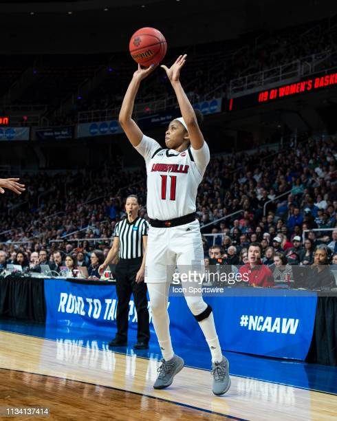 Louisville Cardinals Guard Arica Carter shoots a three point jump shot during the second half of the game between the Connecticut Huskies and the...