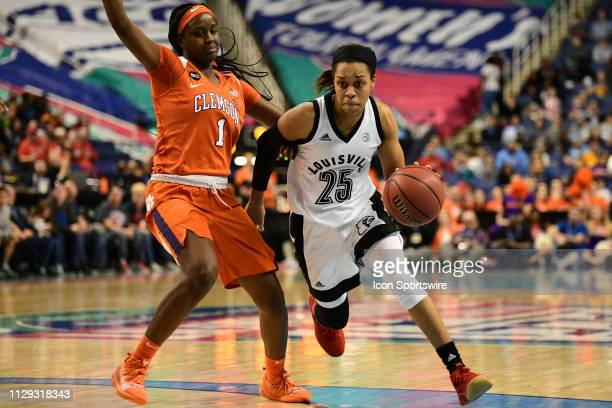 Louisville Cardinals guard Asia Durr dribbles past Clemson Tigers guard Destiny Thomas during the ACC Women's basketball tournament between the...
