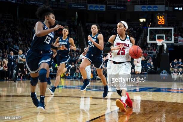 Louisville Cardinals Guard Asia Durr dribbles the ball up the court with Connecticut Huskies Guard Christyn Williams defending during the second half...