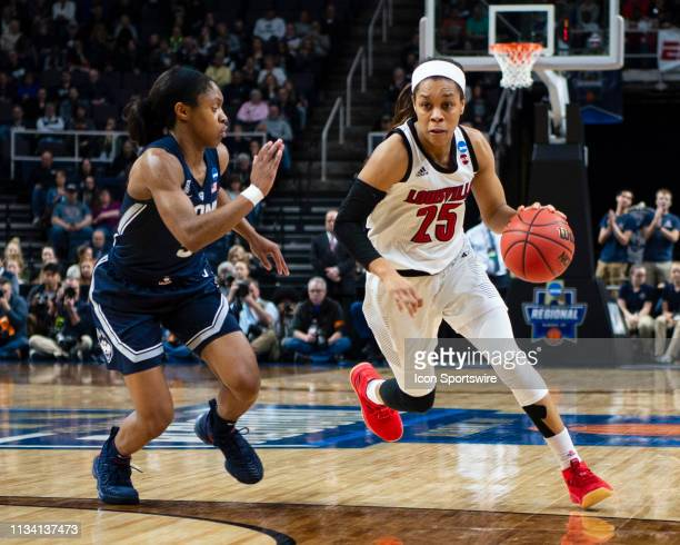 Louisville Cardinals Guard Asia Durr dribbles the ball up the court against Connecticut Huskies Guard Crystal Dangerfield defending during the second...