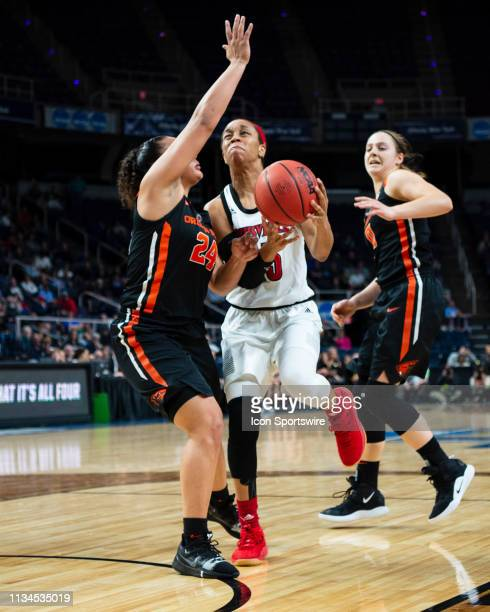 Louisville Cardinals Guard Asia Durr drives to the basket with Oregon State Beavers Guard Destiny Slocum defending during the second half of the game...