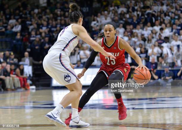 Louisville Cardinals Guard Asia Durr looks to drive to the basket as UConn Huskies Guard Kia Nurse defends during the game as the UConn Huskies host...