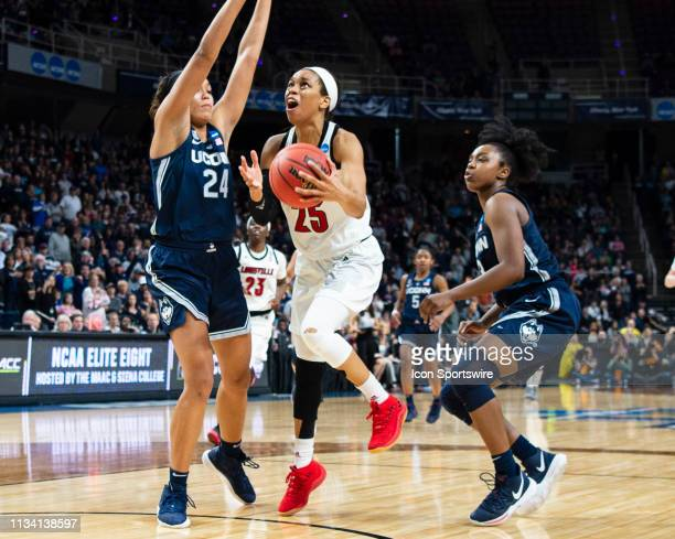 Louisville Cardinals Guard Asia Durr looks to the basket to put up a shot with Connecticut Huskies Forward Napheesa Collier defending during the...