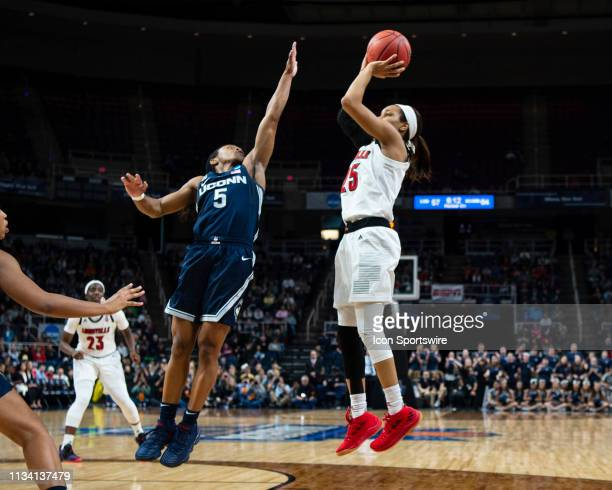 Louisville Cardinals Guard Asia Durr shoots a jump shot with Connecticut Huskies Guard Crystal Dangerfield defending during the second half of the...