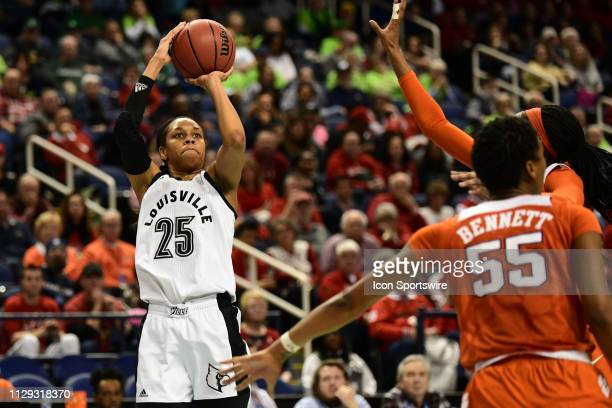 Louisville Cardinals guard Asia Durr shoots a three during the ACC Women's basketball tournament between the Louisville Cardinals and the Clemson...