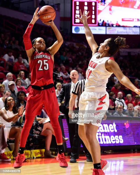 Louisville Cardinals guard Asia Durr shoots over Western Kentucky Lady Toppers guard Alexis Brewer during a college basketball game between the...