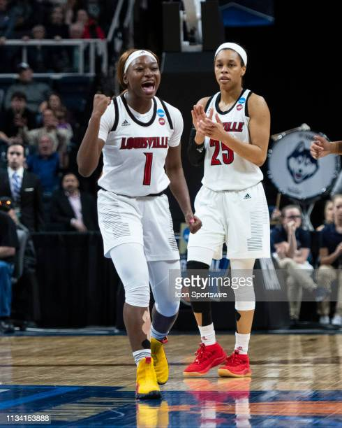 Louisville Cardinals Guard Dana Evans and Louisville Cardinals Guard Asia Durr react to a call on the court during the second half of the game...