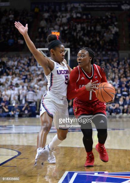 Louisville Cardinals Guard Dana Evans looks to pass as UConn Huskies Guard Crystal Dangerfield defends during the game as the UConn Huskies host the...