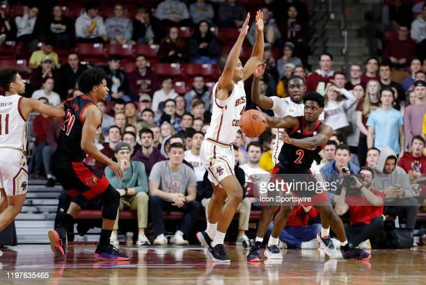 Louisville Cardinals guard Darius Perry passes around Boston College forward Steffon Mitchell during a game between the Boston College Eagles and the...