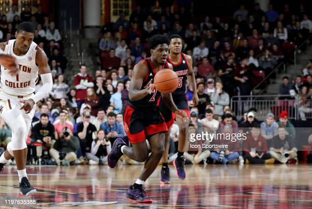 Louisville Cardinals guard Darius Perry pushes the ball up court during a game between the Boston College Eagles and the Louisville Cardinals on...