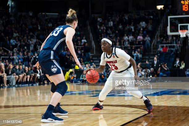 Louisville Cardinals Guard Jazmine Jones dribbles the ball against Connecticut Huskies Guard / Forward Katie Lou Samuelson during the second half of...