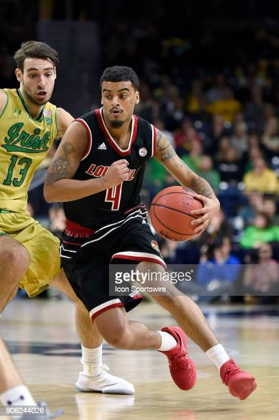 Louisville Cardinals guard Quentin Snider dribbles past Notre Dame Fighting Irish guard Nikola Djogo during the college basketball game between the...
