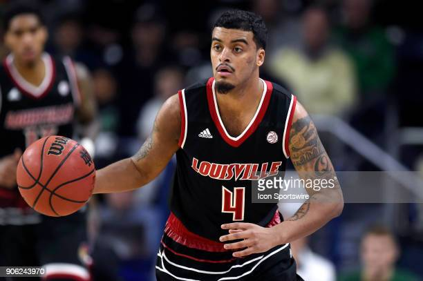 Louisville Cardinals guard Quentin Snider dribbles the basketball during the college basketball game between the Louisville Cardinals and the Notre...