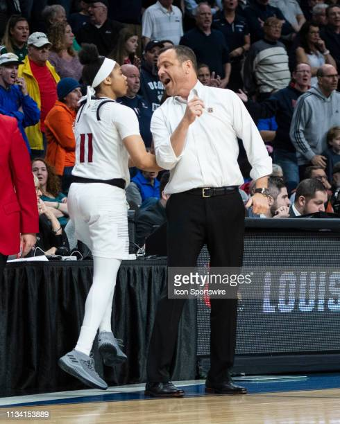 Louisville Cardinals Head Coach Jeff Walz speaks with Louisville Cardinals Guard Arica Carter during the second half of the game between the...