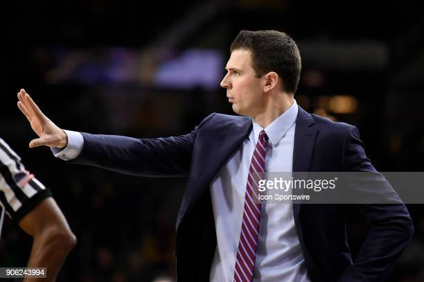 Louisville Cardinals interim head coach David Padgett reacts after a play during the college basketball game between the Louisville Cardinals and the...