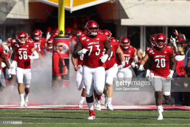 Louisville Cardinals offensive lineman Mekhi Becton runs onto the field before the game against the Clemson Tigers and the Louisville Cardinals on...